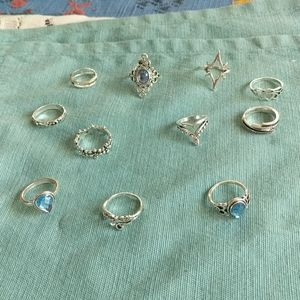 Silver Toned Rings 11 in total .